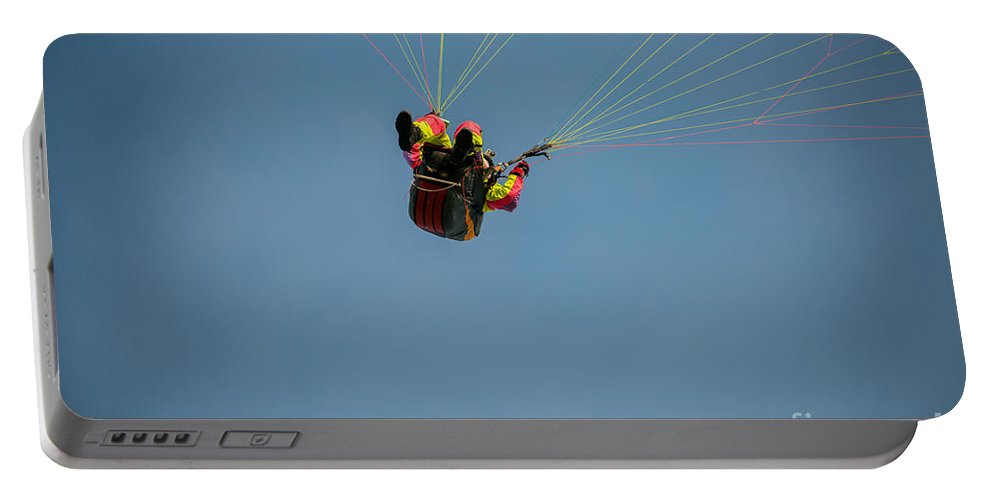 Paragliding Portable Battery Charger featuring the photograph Paragliding by Mats Silvan