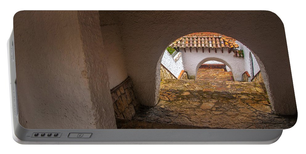 Passage Portable Battery Charger featuring the photograph Passageway In Colonial Town by Jess Kraft