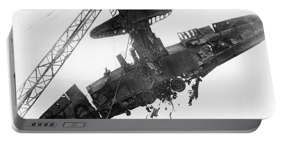 1940s Portable Battery Charger featuring the photograph Pearl Harbor Plane Salvaged by Underwood Archives