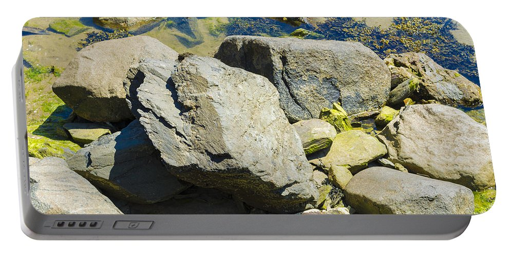 Sea Portable Battery Charger featuring the photograph Pembroke Rock by Mair Hunt