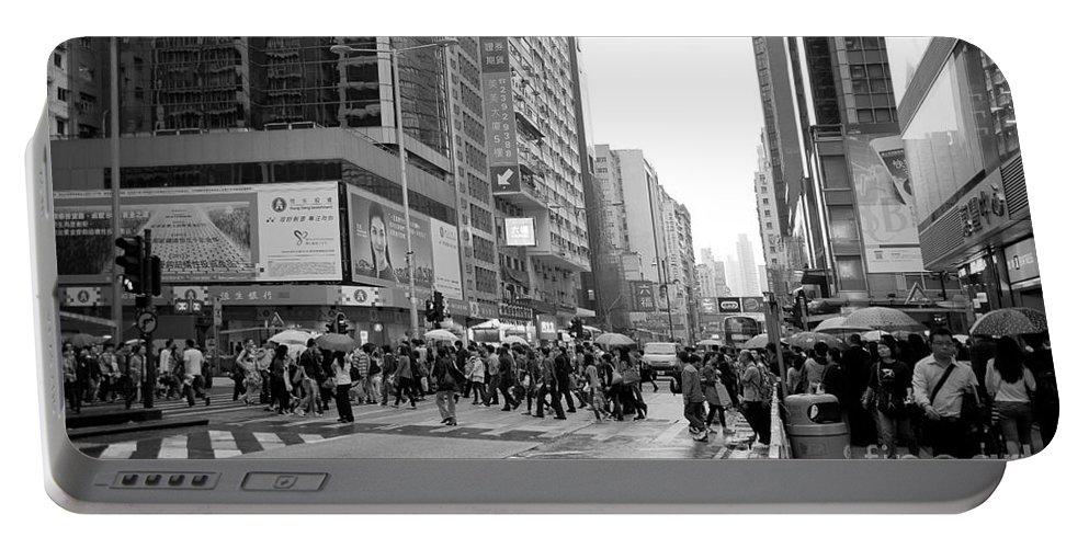 Hong Kong Portable Battery Charger featuring the photograph People Crossing The Street On A Rainy Day In Mong Kok Hong Kong by Ivy Ho