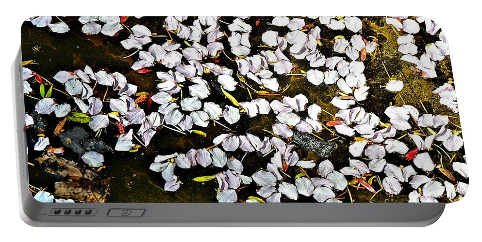 Abstract Portable Battery Charger featuring the photograph Petals In The Pond by Lauren Leigh Hunter Fine Art Photography
