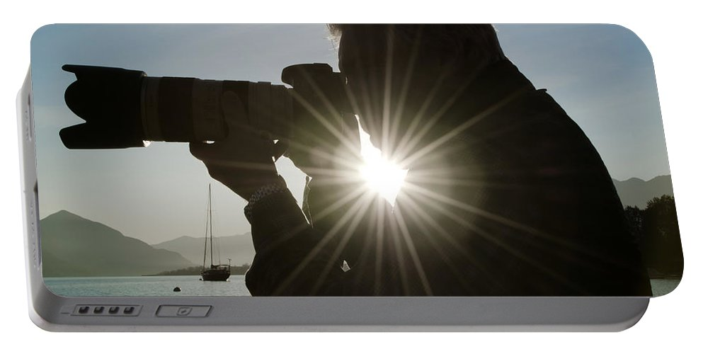 Photgrapher Portable Battery Charger featuring the photograph Photographer by Mats Silvan
