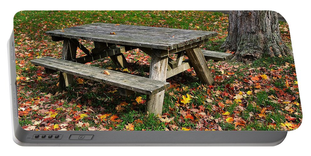 Travel Portable Battery Charger featuring the photograph Picnic Table In Autumn by Louise Heusinkveld