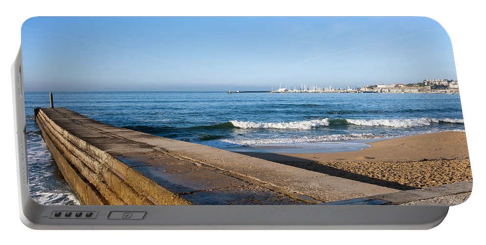 Cascais Portable Battery Charger featuring the photograph Pier And Beach By The Atlantic Ocean In Cascais by Artur Bogacki