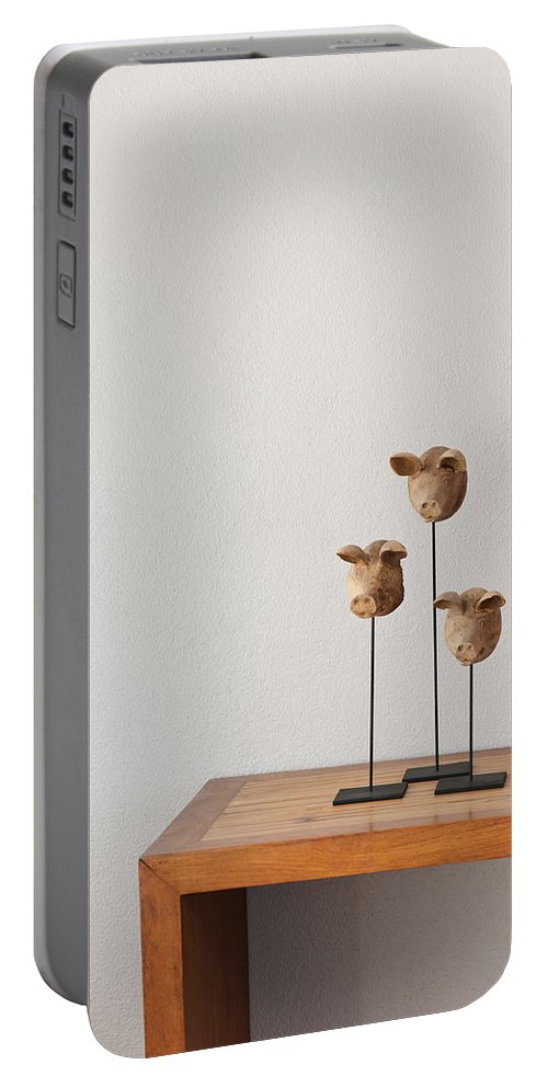 Apartment Portable Battery Charger featuring the photograph Pig Heads by U Schade