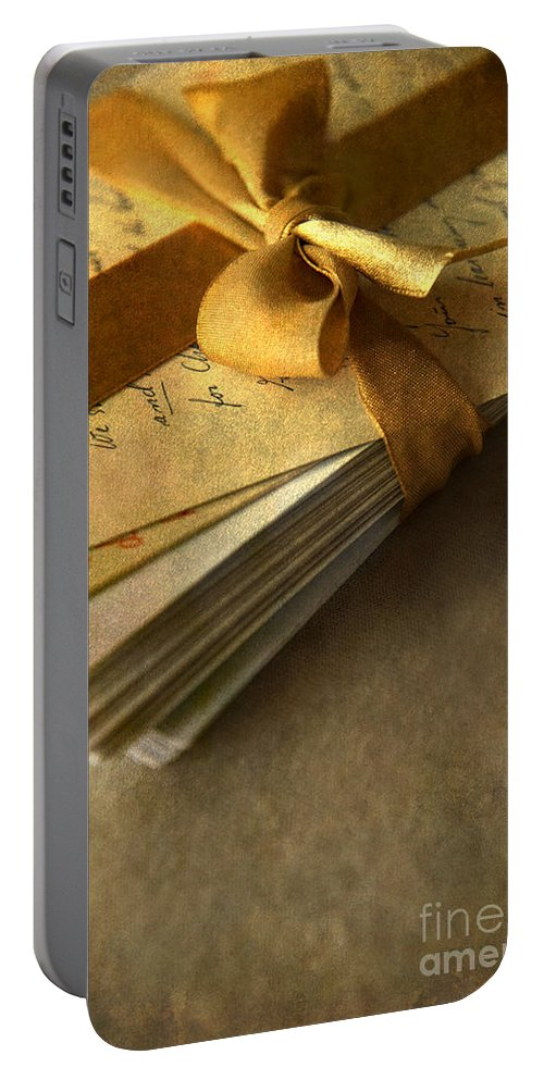 Ribbon Portable Battery Charger featuring the photograph Pile Of Letters With Golden Ribbon by Jaroslaw Blaminsky