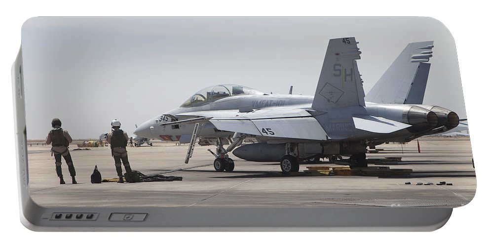 Horizontal Portable Battery Charger featuring the photograph Pilots Wait To Board Their Fa-18b by Timm Ziegenthaler