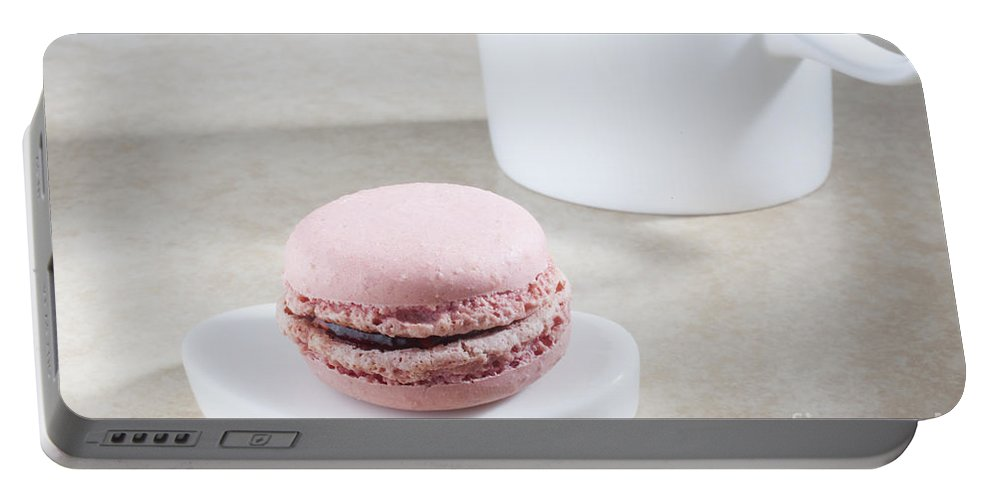 A Pink Macaroon On A Tiny Plate Portable Battery Charger featuring the photograph Pink Macaroon by Liz Leyden