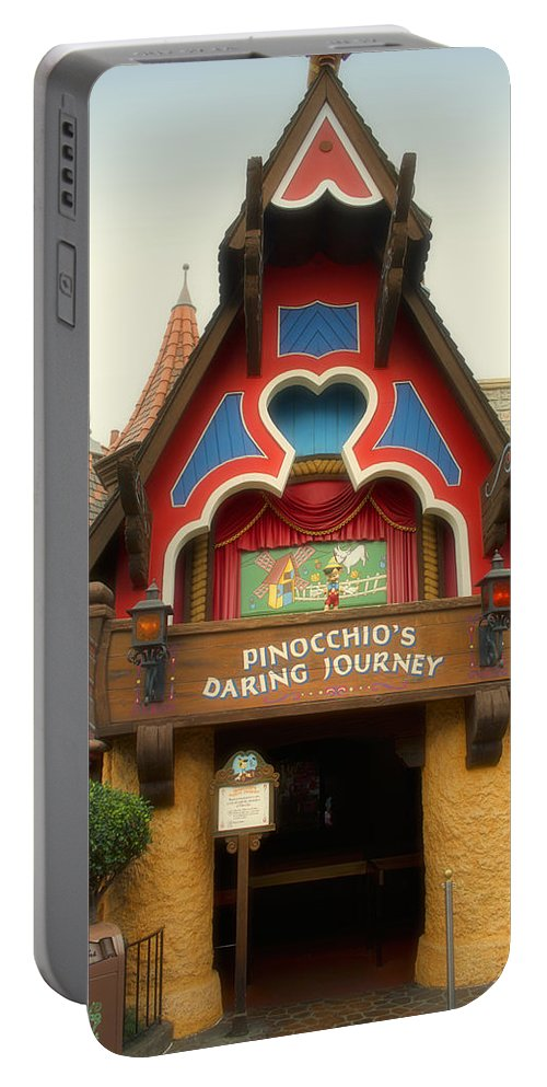Disney Portable Battery Charger featuring the photograph Pinocchio Daring Journey Fantasyland Disneyland by Thomas Woolworth