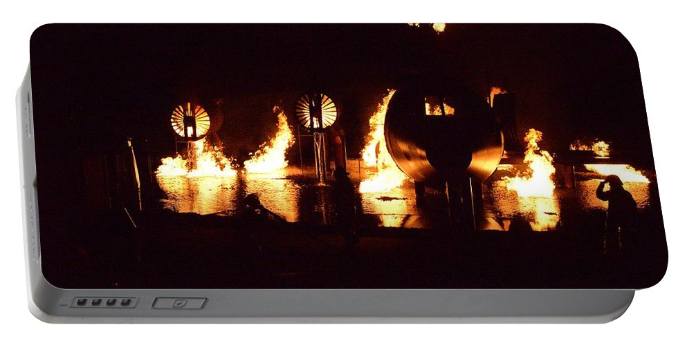 Fire Portable Battery Charger featuring the photograph Plane Ablaze by Aaron Martens