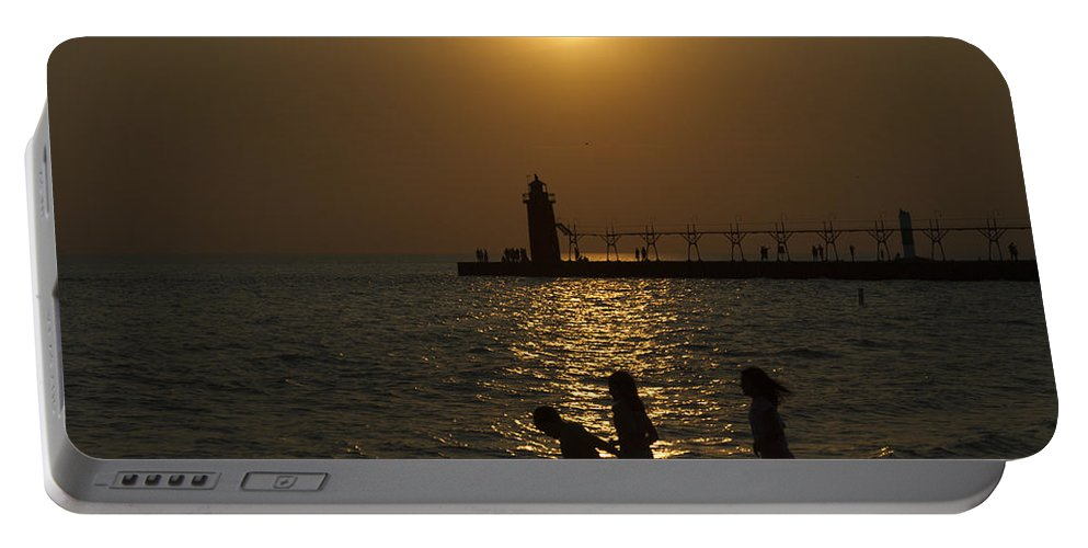 Sunset Portable Battery Charger featuring the photograph Playful Sunset by Jack R Perry