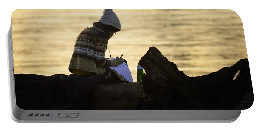 Street Photography Portable Battery Charger featuring the photograph Poems By The Sea by The Artist Project