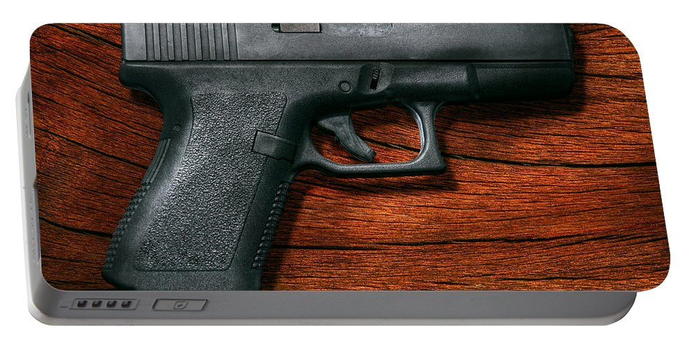 Savad Portable Battery Charger featuring the photograph Police - Gun - The Modern Gun by Mike Savad