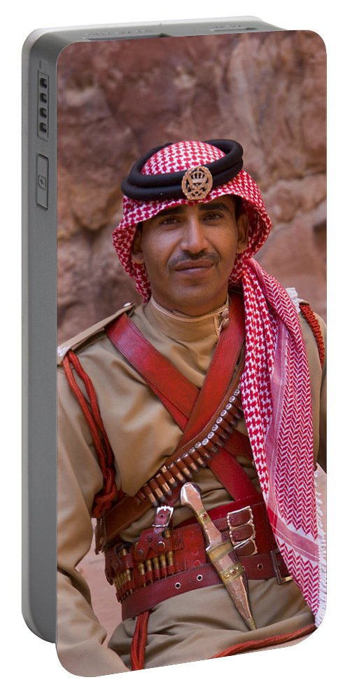 Jordanian Portable Battery Charger featuring the photograph Policeman In Petra Jordan by David Smith