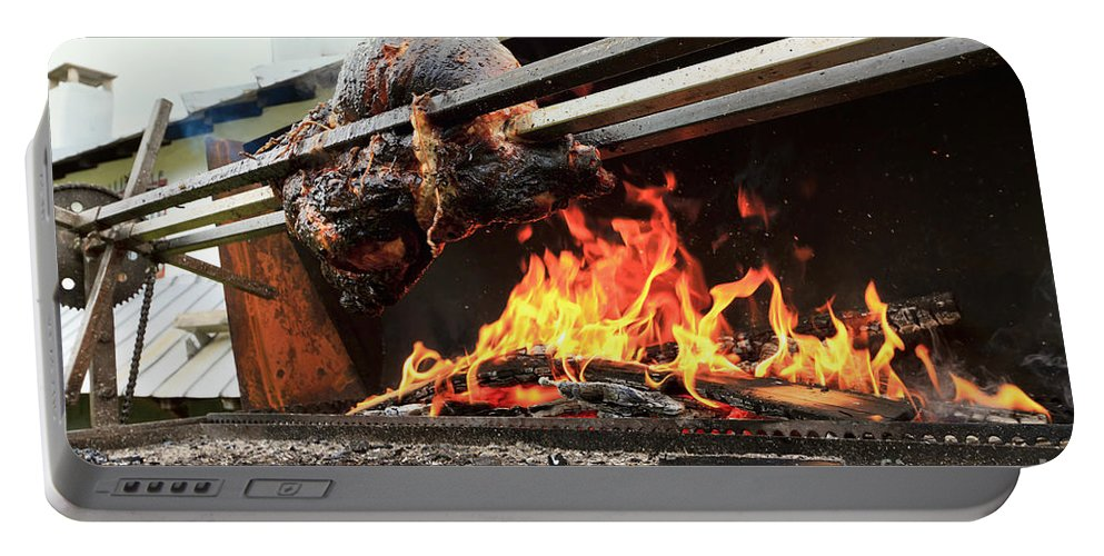 Animal Portable Battery Charger featuring the photograph Pork Grilled by Antonio Scarpi
