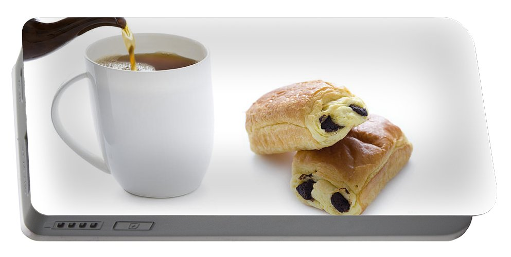 Brown Portable Battery Charger featuring the photograph Pouring Tea With Pain Au Chocolat by Lee Avison