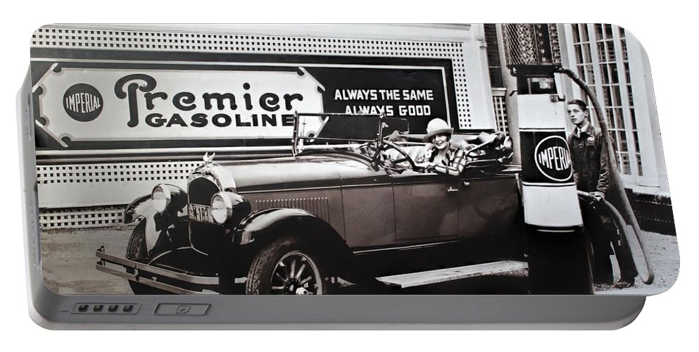 Nostalgia Portable Battery Charger featuring the photograph Premier Gasoline by Carlos Diaz