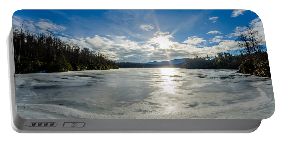 Price Lake Portable Battery Charger featuring the photograph Price Lake Frozen Over During Winter Months In North Carolina by Alex Grichenko