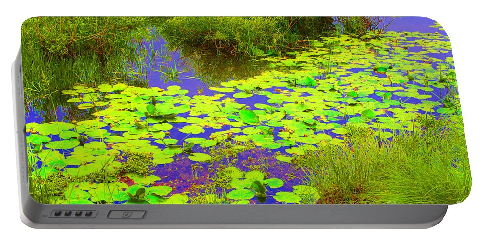 Lily Portable Battery Charger featuring the photograph Psychedelic Lily Pads by Ray Konopaske