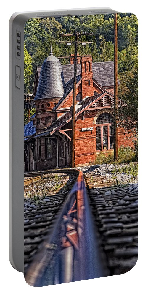 Railroad Track Portable Battery Charger featuring the photograph Rail Reflection At The Train Station by Timothy Flanigan