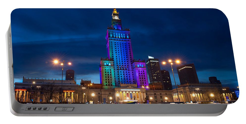 Attraction Portable Battery Charger featuring the photograph Palace Of Science And Culture In Rainbow Colors by Arletta Cwalina