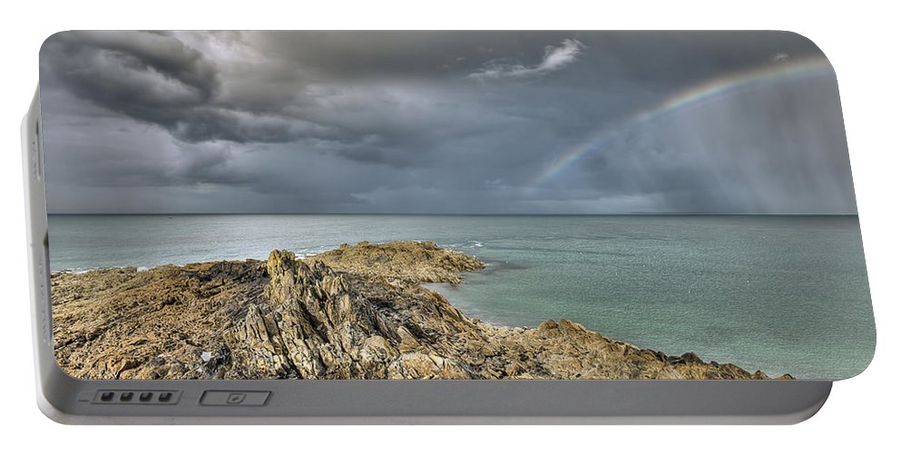 Rainbow Portable Battery Charger featuring the photograph Rainbow In Storm Clouds Pointe De Saint Cast by Gary Eason