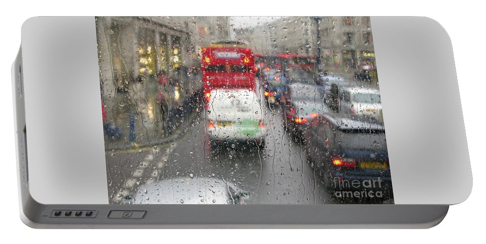 London Portable Battery Charger featuring the photograph Rainy Day London Traffic by Ann Horn