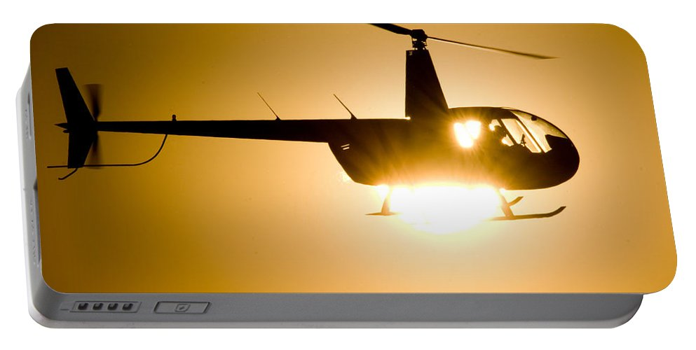 Robinson R44 Raven Ii Portable Battery Charger featuring the photograph Raven Sun by Paul Job