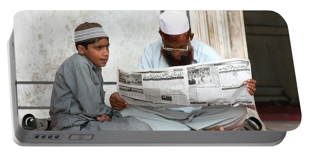 Street Photography Portable Battery Charger featuring the photograph Reading In New Delhi by Amanda Stadther