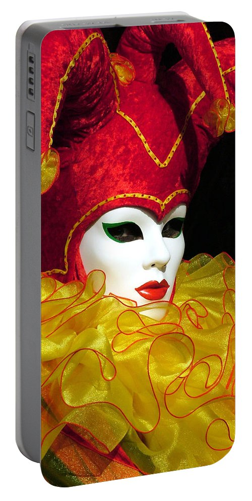 Venice Carnival Portable Battery Charger featuring the photograph Red And Yellow Jester by Donna Corless