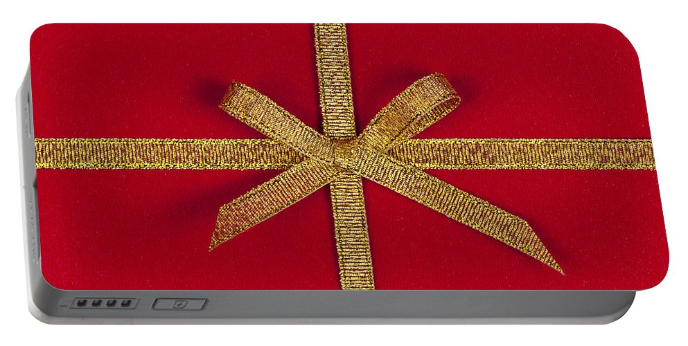 Gift Portable Battery Charger featuring the photograph Red Gift With Gold Ribbon by Elena Elisseeva