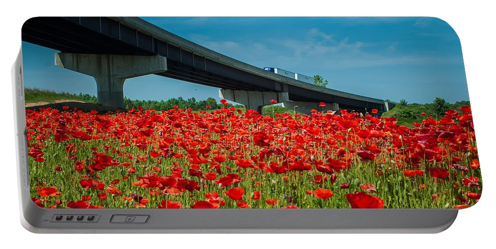 Freeway Portable Battery Charger featuring the photograph Red Poppy Field Near Highway Road by Alex Grichenko