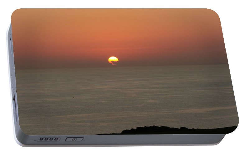 Red Sunset Over Sea Portable Battery Charger featuring the photograph Red Sunset Over Sea by Gordon Auld