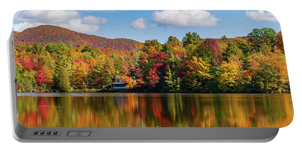 Photography Portable Battery Charger featuring the photograph Reflection Of Autumn Trees In A Pond by Panoramic Images