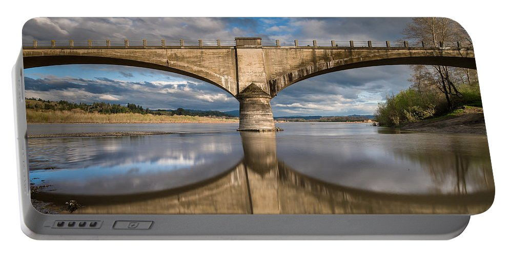 Fernbridge Portable Battery Charger featuring the photograph Reflections On A Rising River by Greg Nyquist