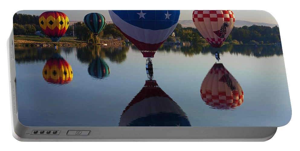 Balloons Portable Battery Charger featuring the photograph Resting On The Water by Mike Dawson