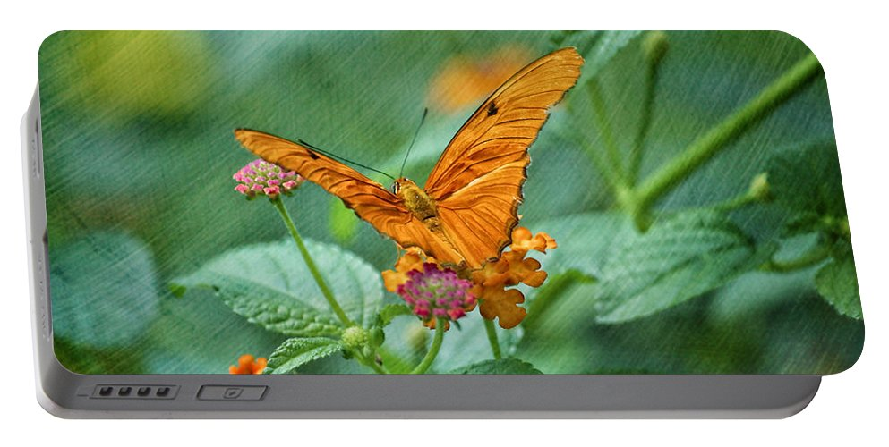 Butterfly Portable Battery Charger featuring the photograph Resting Orange Butterfly by Thomas Woolworth