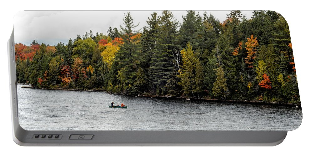 Return Portable Battery Charger featuring the photograph Returning From A Canoe Trip by Les Palenik