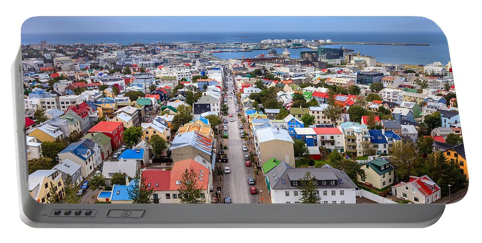 Europe Portable Battery Charger featuring the photograph Reykjavik Rooftops by Alexey Stiop