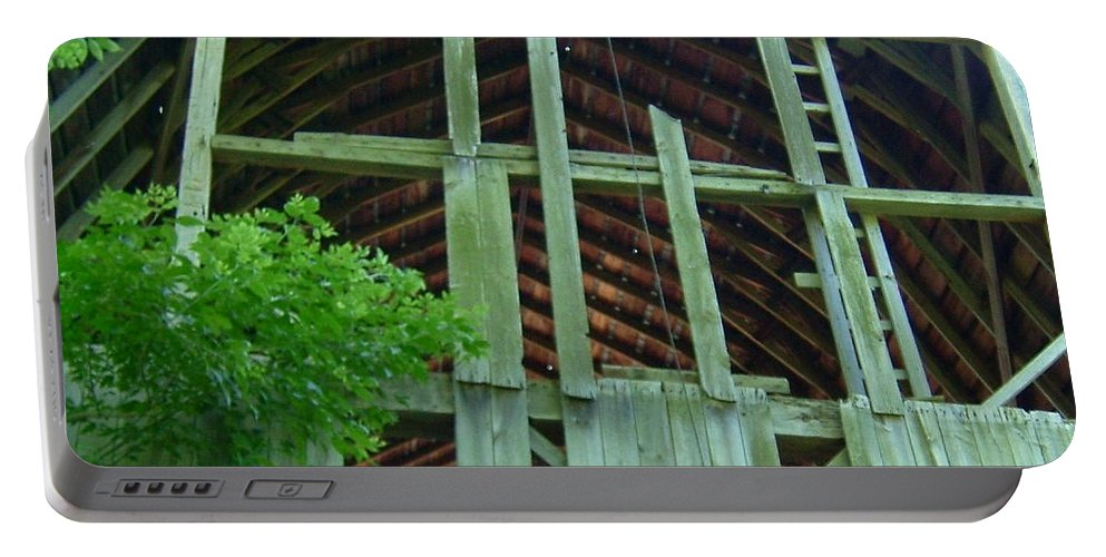 Sun Portable Battery Charger featuring the photograph Ribs Of A Decaying Barn by Susan Wyman