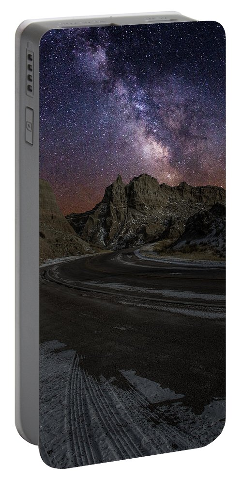 Milkyway Portable Battery Charger featuring the photograph Ride Across The Badlands by Aaron J Groen