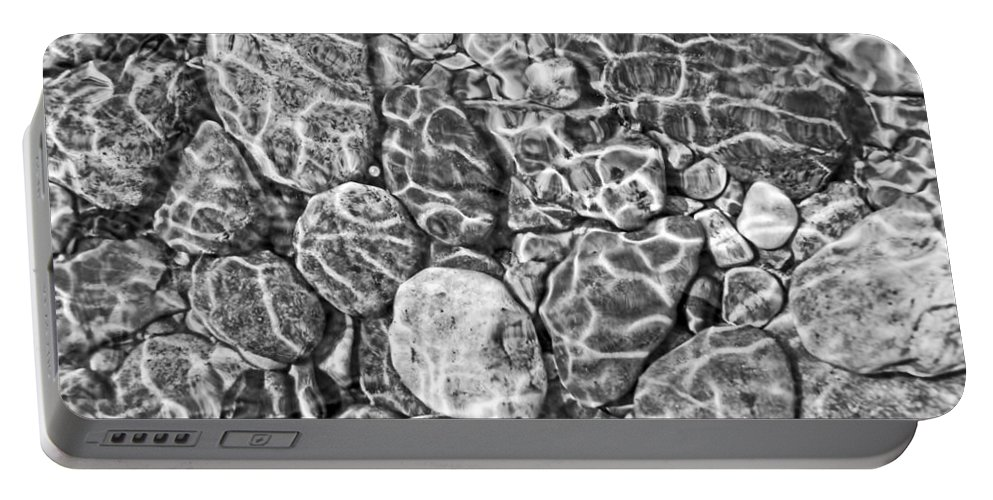 Rock Portable Battery Charger featuring the photograph River Rocks In Stream Bed Monochrome by Jennie Marie Schell