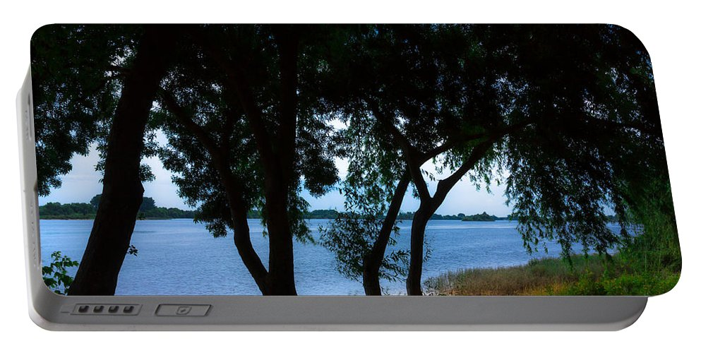 Light Portable Battery Charger featuring the photograph Riverside by Edgar Laureano