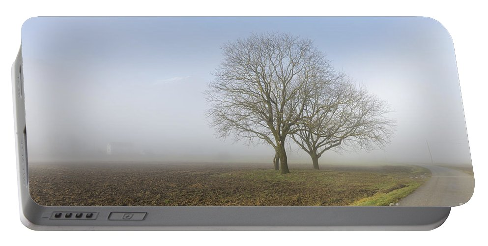 Street Portable Battery Charger featuring the photograph Road In The Fog by Mats Silvan