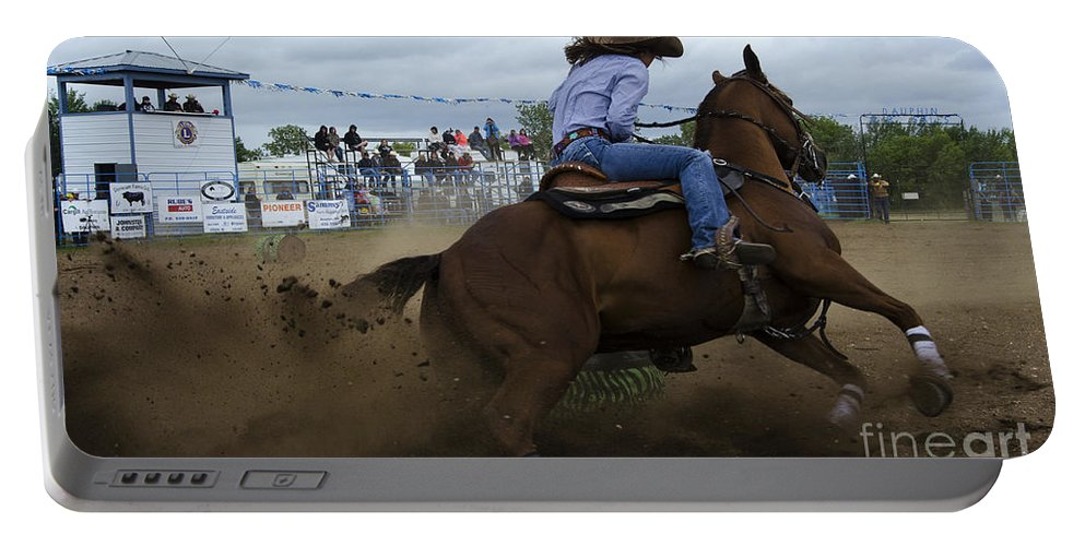 Barrel Portable Battery Charger featuring the photograph Rodeo Ladies Barrel Race 1 by Bob Christopher