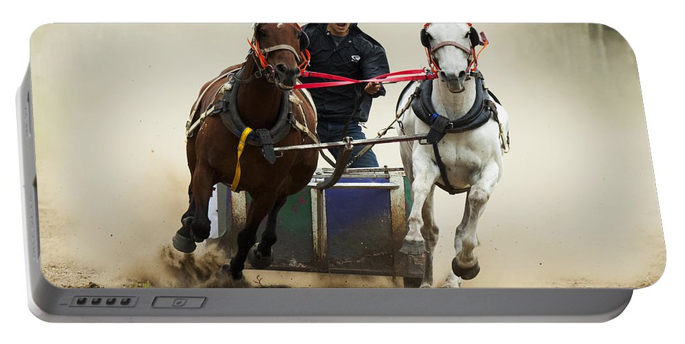 Chariot Race Portable Battery Charger featuring the photograph Rodeo Leader Of The Pack by Bob Christopher