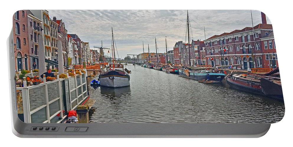 Travel Portable Battery Charger featuring the photograph Rotterdam Canal by Elvis Vaughn