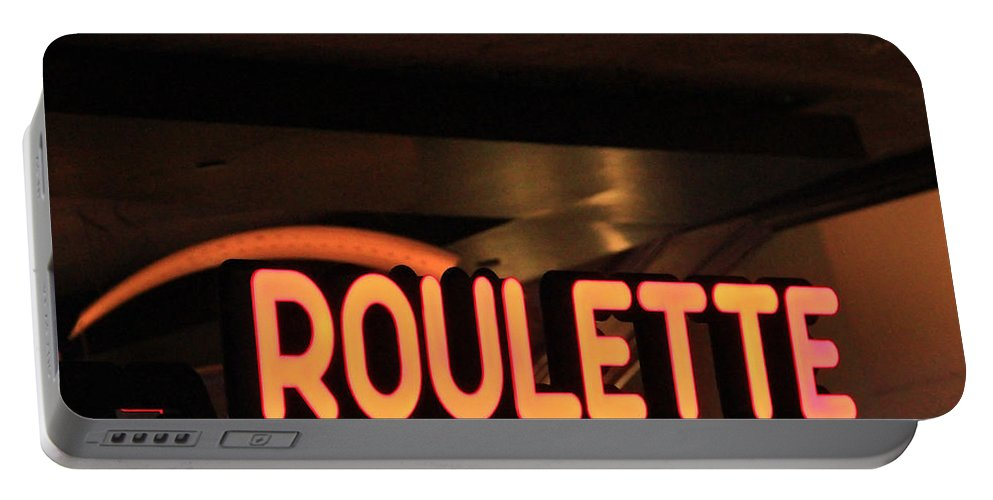 Roulette Portable Battery Charger featuring the photograph Roulette by Eti Reid