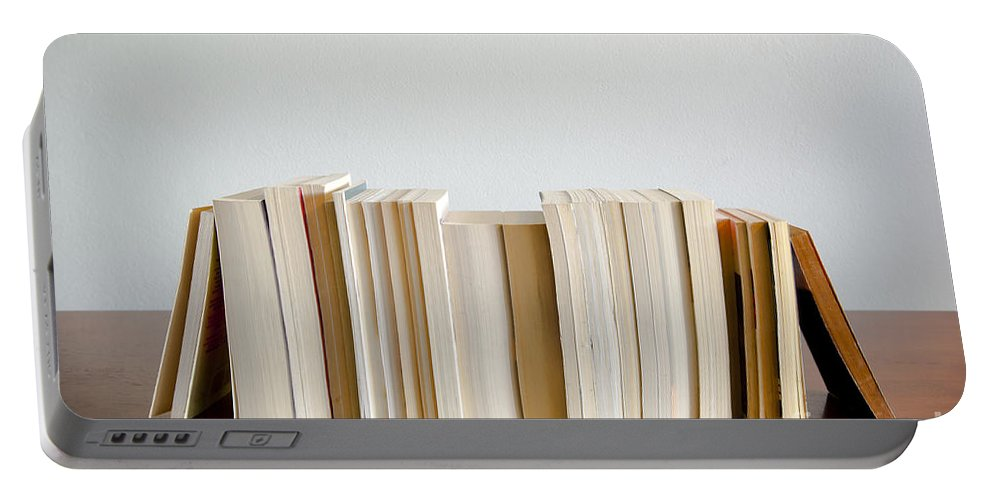 Book Portable Battery Charger featuring the photograph Row Of Books by Tim Hester